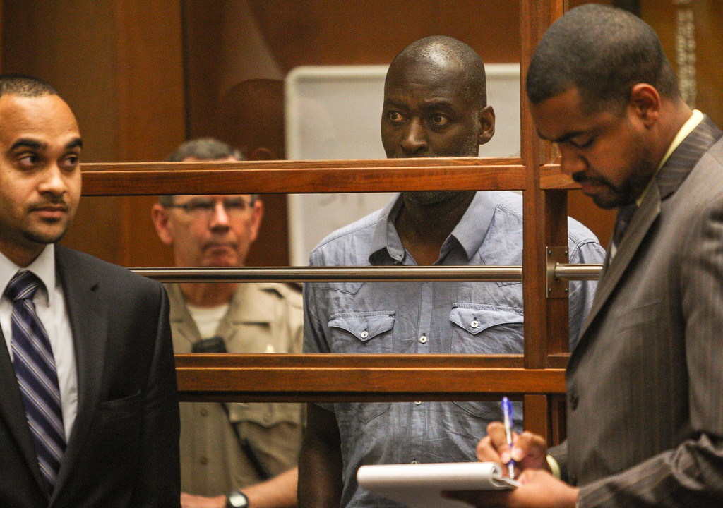 """. Actor Michael Jace appears in court in Los Angeles Thursday, May. 22, 2014.  A judge has delayed the arraignment of  Jace on a murder charge filed over his wife\'s shooting death earlier this week. Attorneys for Jace, who played a police officer in the hit TV series \""""The Shield,\"""" sought a continuance during the actor\'s first court appearance in Los Angeles on Thursday. He\'s due back in court June 18. The 51-year-old was charged Thursday with a single count of murder and he is accused of shooting his wife April multiple times in their home Monday evening. (AP Photo/David McNew, Pool"""