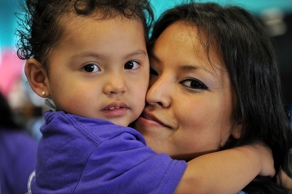 . 5/4/13 - Tianah Montesoro, 2,  hugs her mom Carmen Chavez during  a visit at the California Institution for Women. The mothers and children were united by the non-profit organization entitled Get On The Bus which provides an annual event of free transportation for the children and their caregivers to the prison. The visit becomes more of an event, with snacks, lunch, arts, crafts, photos, keepsakes and plenty of hugs and kisses. The program began in 2000 with one bus one prison and 17 kids. Today children are able to visit their mothers and fathers with 60 buses, seven prisons and more than a thousand kids. Photo by Brittany Murray / Staff Photographer