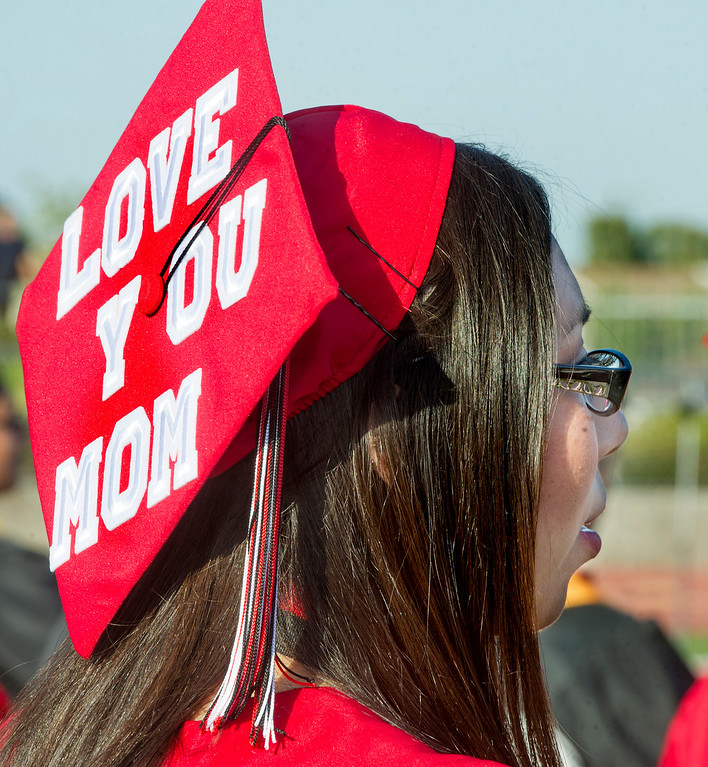 ". Kimberly Caldera with a  message on her cap, ""Love You Mom\"", at Sierra Vista High School Graduation in Baldwin Park Thursday, May 30, 2013.    (Walt Mancini/San Gabriel Valley News)"