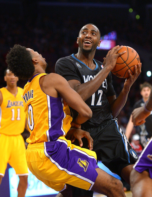 . Timberwolves\' Luc Richard Mbah a Moute is called for an offensive foul after charging into the Lakers\' Nick Young, Friday, December 20, 2013, at Staples Center. (Photo by Michael Owen Baker/L.A. Daily News)