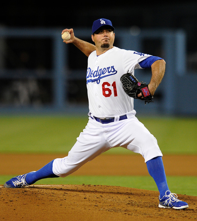 . <b>JOSH BECKETT</b> <br />The right-hander was once the darling of Boston after helping pitch the Red Sox to the 2007 World Series title. But some clubhouse controversies and some zip off his fastball, along with a contract that pays him $15.75 million this season and next, made him part of the deal. After eight uneventful starts to start 2013, Beckett was diagnosed with thoracic outlet syndrome and had season-ending neck surgery in July.   (John McCoy/L.A. Daily News)