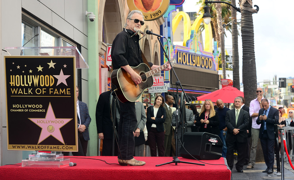 ". Kris Kristofferson performs ""Me & Bobby McGee\"" live on Hollywood Boulevard during posthumous Star ceremony for the late Janis Joplin on November 4, 2013 in Hollywood, California. Joplin, who had her siblings Michael and Laura at the ceremony, would have turned 70 years old this year and is the recipient of the 2,510th Star on the Hollywood Walk of Fame in the Category of Recording.         (FREDERIC J. BROWN/AFP/Getty Images)"