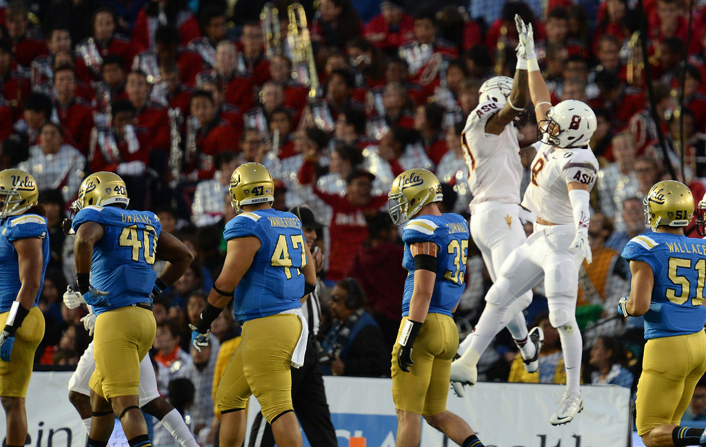 . Arizona State�s D.J. Foster #8 celebrates scoring a touchdown with Jaelen Strong #21 during their game against UCLA at the Rose Bowl Saturday November 23, 2013. (Photos by Hans Gutknecht/Los Angeles Daily News)