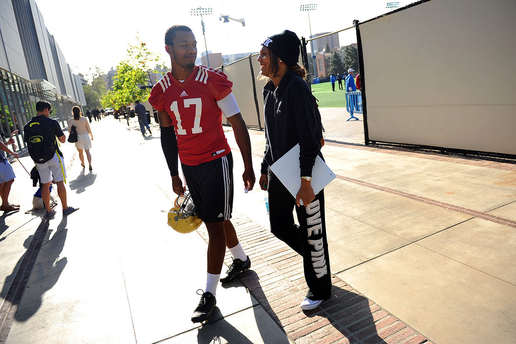 . UCLA Quarterback Brett Hundley walks with Dawnielle Baucham following the final day of spring practice Thursday, April 24, 2014.(Andy Holzman/Los Angeles Daily News)