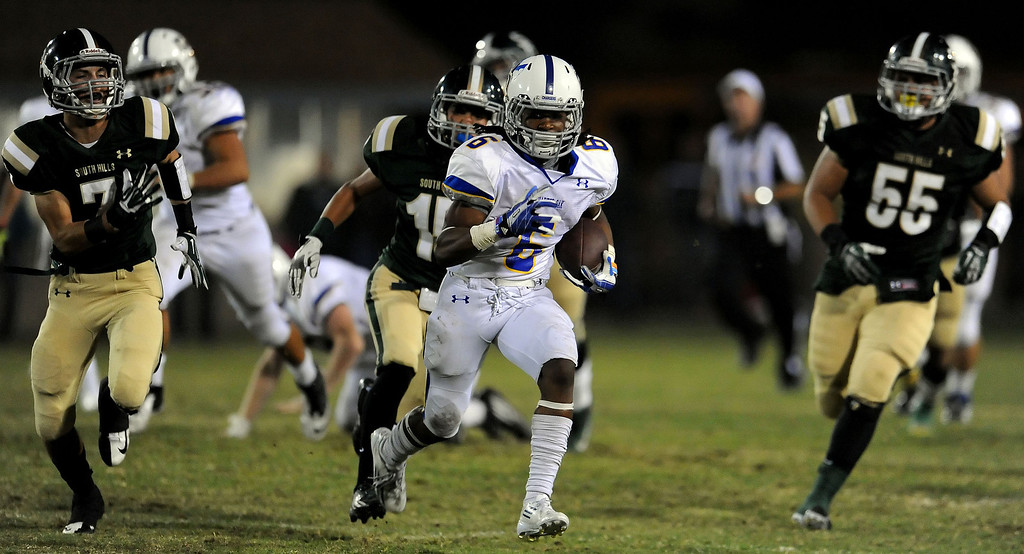 . Charter Oak\'s Zion Echols (6) catches a pass and runs for a first down against South Hills in the first half of a prep football game at Covina DIstrict Field in Covina, Calif., on Thursday, Oct. 24, 2013. 