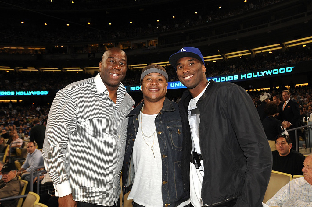""". (L-R) Earvin \""""Magic\"""" Johnson, rapper LL Cool J and Kobe Bryant of the Los Angeles Lakers attend a game between the Los Angeles Dodgers and the New York Yankees on July 31, 2013 at Dodger Stadium in Los Angeles, Caifornia. (Photo by Jill Weisledero/Los Angeles Dodgers via Getty Images)"""