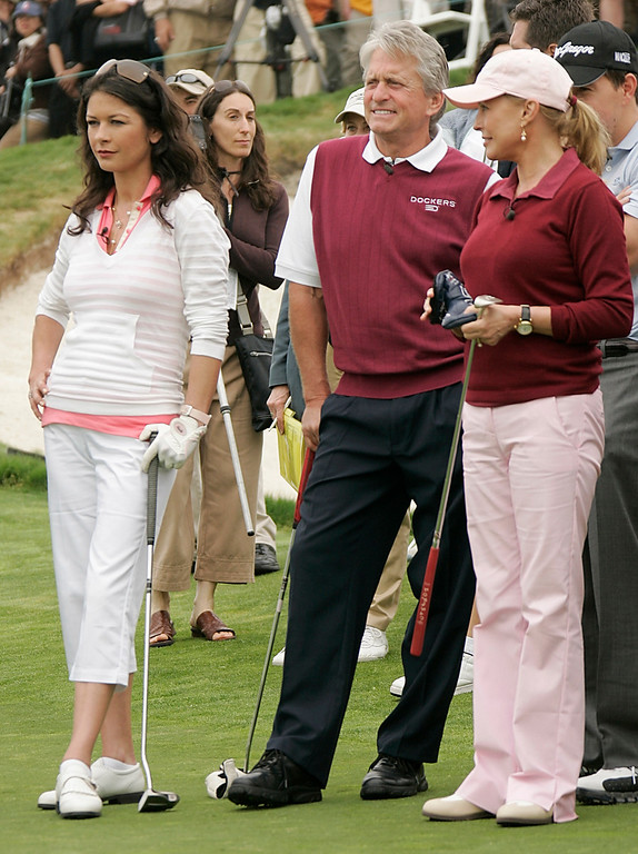 . Actress Catherine Zeta Jones, left, husband, actor Michael Douglas, center, and actress Cheryl Ladd, right, on the green at the 9th annual Michael Douglas and Friends Celebrity Golf event in Rancho Palos Verdes, Calif. on Sunday, April 29, 2007. (AP Photo/Dan Steinberg)