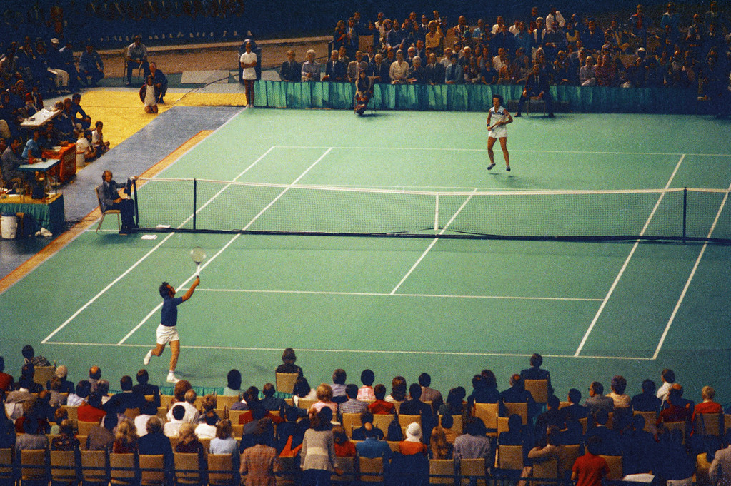 ". Tennis star Bobby Riggs, bottom, and Billie Jean King are shown in action during the ""Battle of the Sexes\"" match in the Astrodome in Houston, Tex., Sept. 20, 1973.  (AP Photo)"