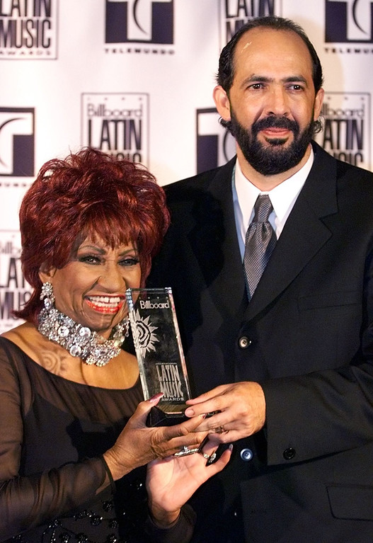 . MIAMI BEACH, UNITED STATES:  Juan Luis Guerra (R) of the Dominican Republic holds his award with Celia Cruz at the Billboard Latin Music Awards 22 April 1999 at the Fountainebleau Hotel on Miami Beach, FL. (ROBERTO SCHMIDT/AFP/Getty Images)