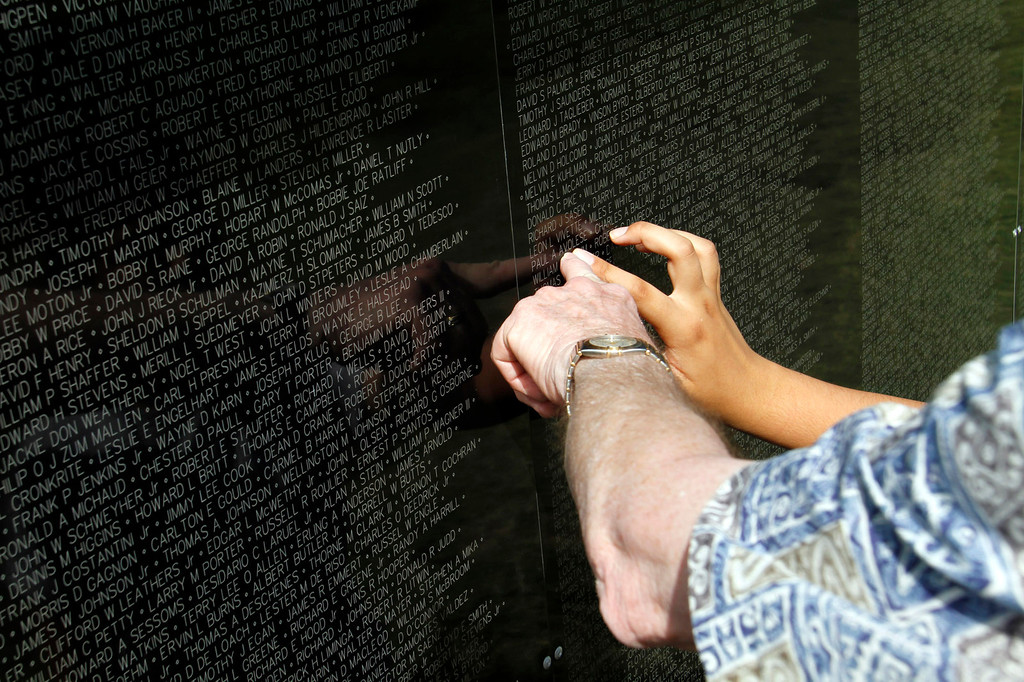 """. Families look for names of relatives on the Vietnam Veterans Memorial, during the Vietnam Veterans Memorial \""""The Wall That Heals\"""" Closing Ceremony event, at La Habra High School, in La Habra, Sunday, July 14, 2013. (SGVN/Correspondent Photo by James Carbone)"""