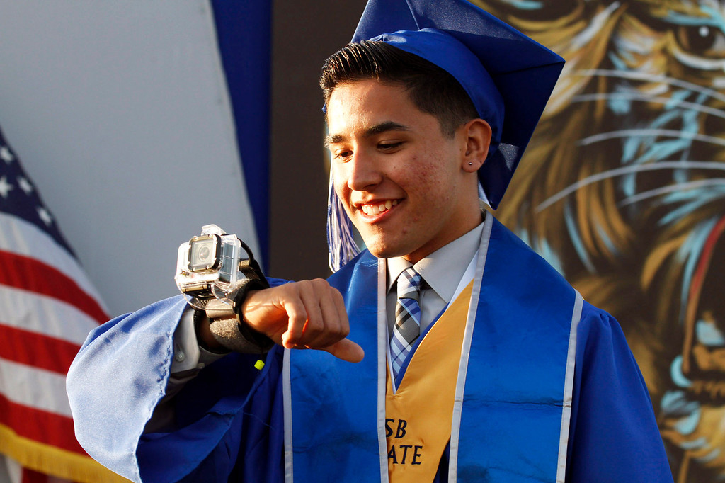 ". El Monte High School ASB President Mark Valazco, uses a ""gopro\"" to document the El Monte High School Class of 2014 Commencement Ceremony, at El Monte High School\'s Football Stadium in El Monte, CA., Wednesday, June 11, 2014.  (Photo by James Carbone for the San Gabriel Valley Tribune)"