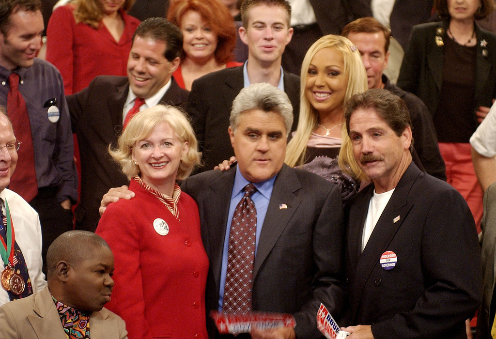 """. Jay Leno, center, poses with gubernatorial candidates actor Gary Coleman, left, Iris Adams, second left, and Douglas Anderson and the rest of 81 candidates after a taping of the Tonight Show Monday, Sept. 22, 2003, at NBC Studios in Burbank, Calif.  Standing in between Leno and Anderson is adult film actress Mary \""""Mary Carey\"""" Cook. The late-night host in August made an offer to the 135 candidates vying to replace Gov. Gray Davis to come on his show. (AP Photo/Kevork Djansezian)"""