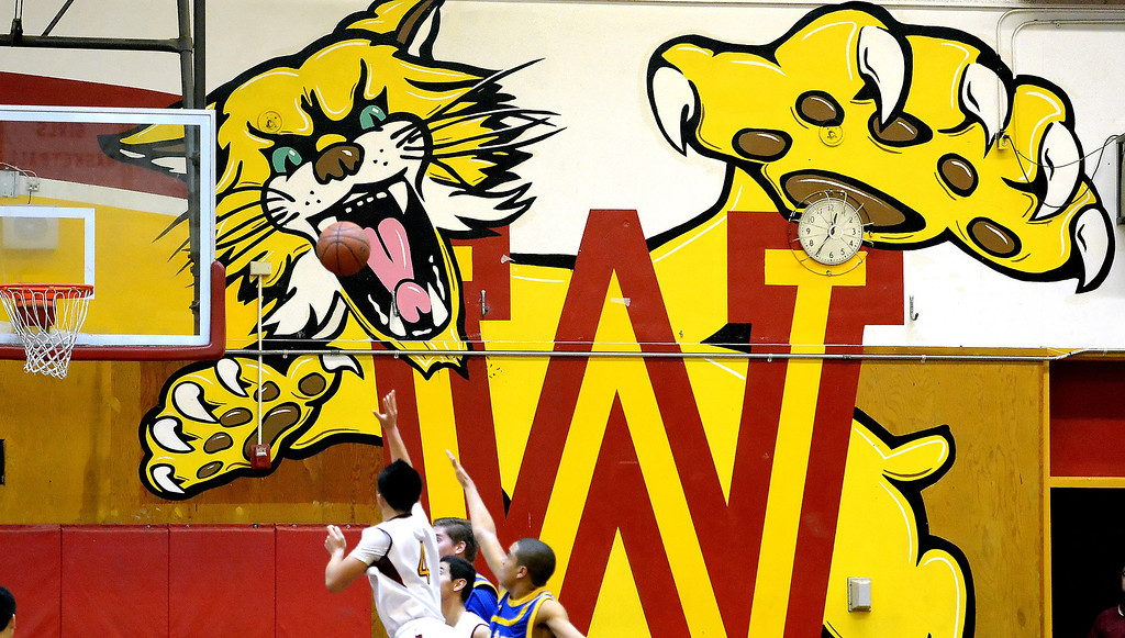 . Wilson\'s Justin Chan (4) shoots in the first half of a prep basketball game against San Dimas at Wilson High School in Hacienda Heights, Calif., on Friday, Jan. 31, 2014. (Keith Birmingham Pasadena Star-News)