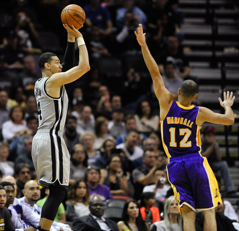 . San Antonio Spurs guard Danny Green shoots a 3-pointer against Los Angeles Lakers guard Kendall Marshall in the first half of an NBA basketball game Friday, March 14, 2014 in San Antonio. (AP Photo/Bahram Mark Sobhani)