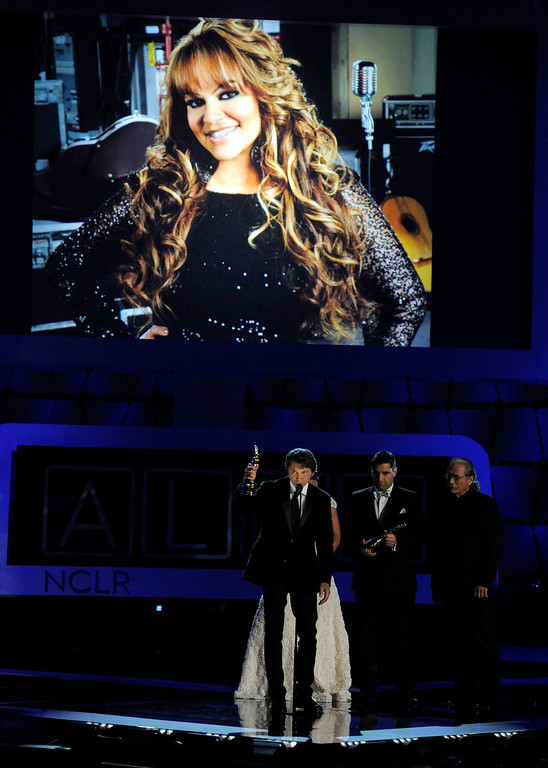 """. The cast of \""""Filly Brown\"""" presents a tribute to Jenni Rivera, seen on screen, at the NCLR ALMA Awards at the Pasadena Civic Auditorium on Friday, Sept. 27, 2013, in Pasadena, Calif. (Photo by Chris Pizzello/Invision/AP)"""