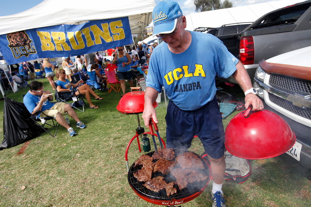 . Dick Bruich of Riverside barbeques before the UCLA-Nevada game at the Rose Bowl, Saturday, August 31, 2013. (Michael Owen Baker/L.A. Daily News)