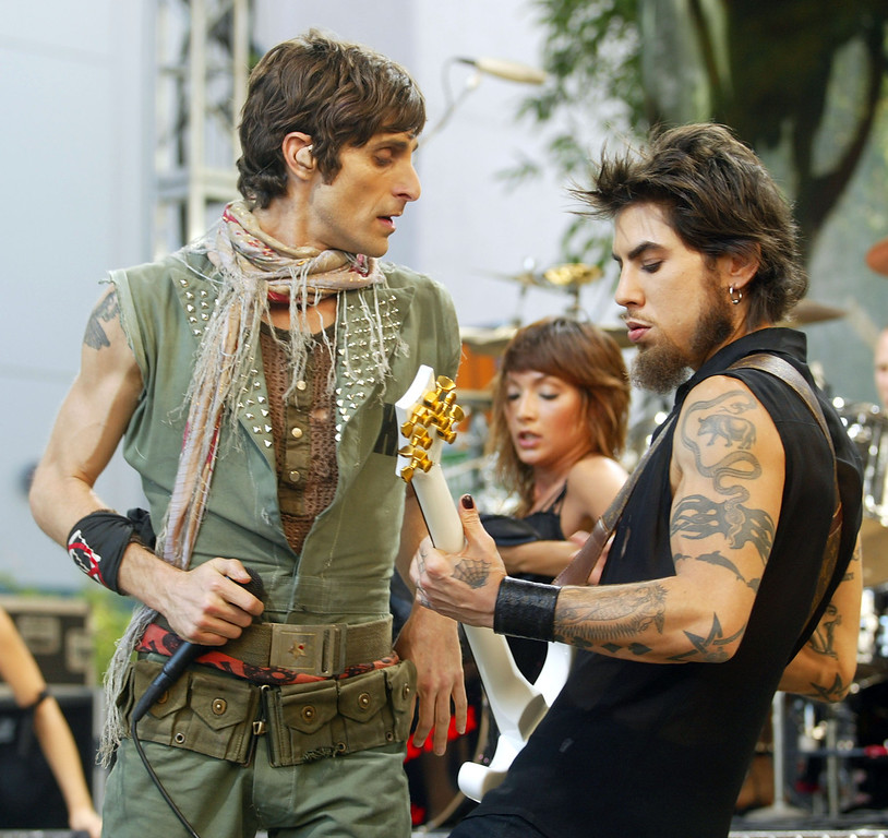". BURBANK, CA - SEPTEMBER 5:  Perry Farrell (L) and Dave Navarro of Jane\'s Addiction perform on ""The Tonight Show with Jay Leno\"" at the NBC Studios on September 5, 2003 in Burbank, California. (Photo by Kevin Winter/Getty Images)"