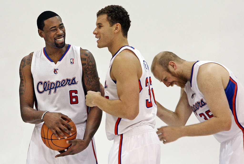 . From left, Los Angeles Clippers newly-re-signed center DeAndre Jordan (6), forward Blake Griffin (32) and center Chris Kaman (35) laugh before posing for a group photo at NBA basketball media day in Los Angeles, Tuesday, Dec. 13, 2011. (AP Photo/Reed Saxon)