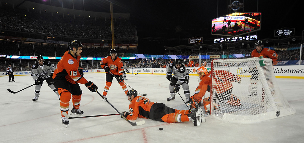 . Anaheim Ducks defenseman Francois Beauchemin (23) dives on a shot by Los Angeles Kings center Mike Richards (10) in the first period of the inaugural NHL Stadium Series game at Dodger Stadium in Los Angeles on Saturday, Jan. 25, 2014. (Keith Birmingham Pasadena Star-News)
