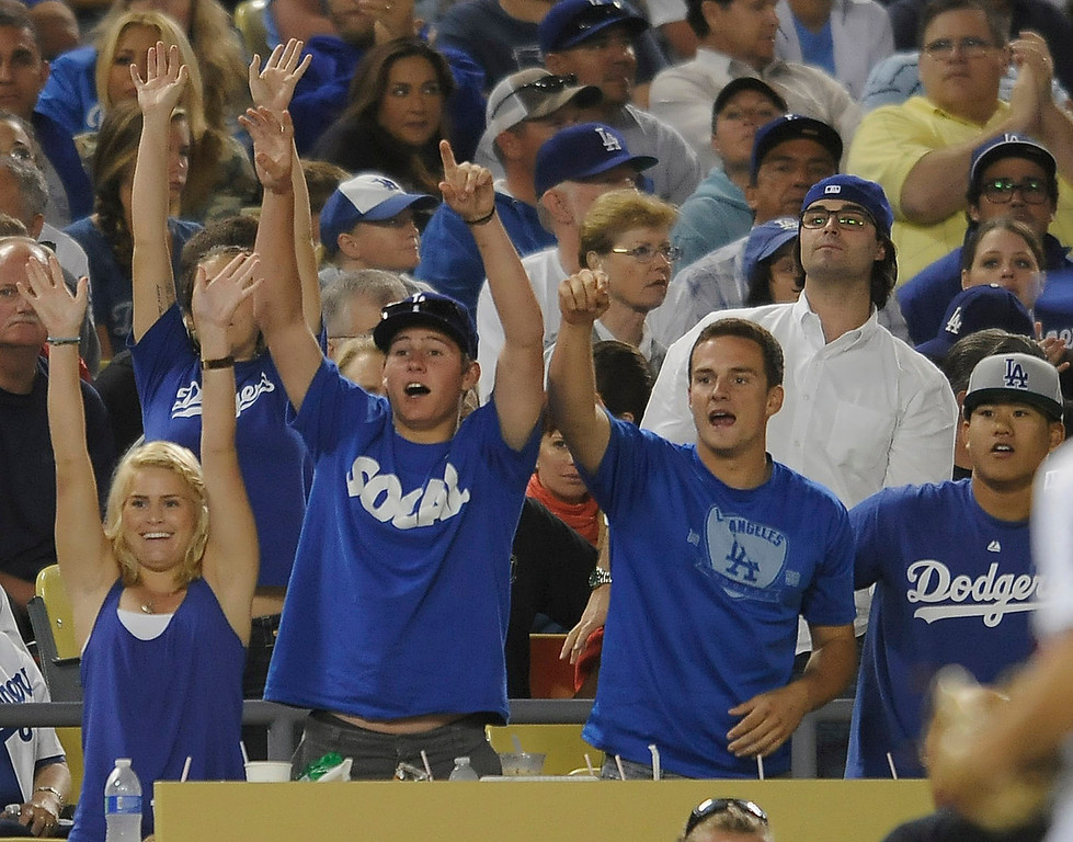 . Fans ask for a ball to be tossed to them at the end of an inning. Fans at Dodger Stadium have been treated to a lot of excitement. The Dodgers defeated the New York Mets 5-4 in 12 innings Wednesday night at Dodger Stadium in Los Angeles, CA. 8/13/2013(John McCoy/LA Daily News)