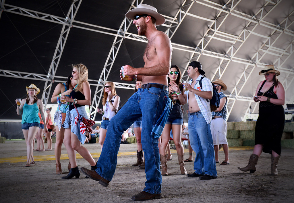 . Festival-goer Paul George, of Chatsworth, dances to Shakey Graves as he performs during the first day of Stagecoach Country Music Festival in Indio, Friday, April 25, 2014. (Photo by Sarah Reingewirtz/Pasadena Star-News)