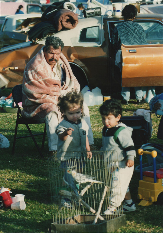 . A man watches over his children as they play with a bird at Lanark Park in Canoga Park, CA. 1/17/1994, photo by (John McCoy/Los Angeles Daily News)