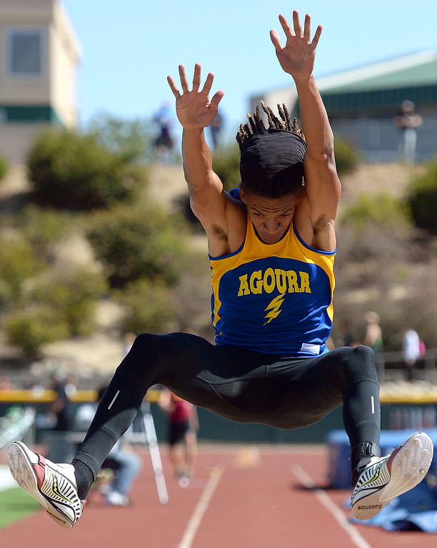 . Agoura High School\'s Idrees Bernard competes in the long jump during the Marmonte League track and field finals May 9, 2014 in Moorpark.(Andy Holzman/Los Angeles Daily News)