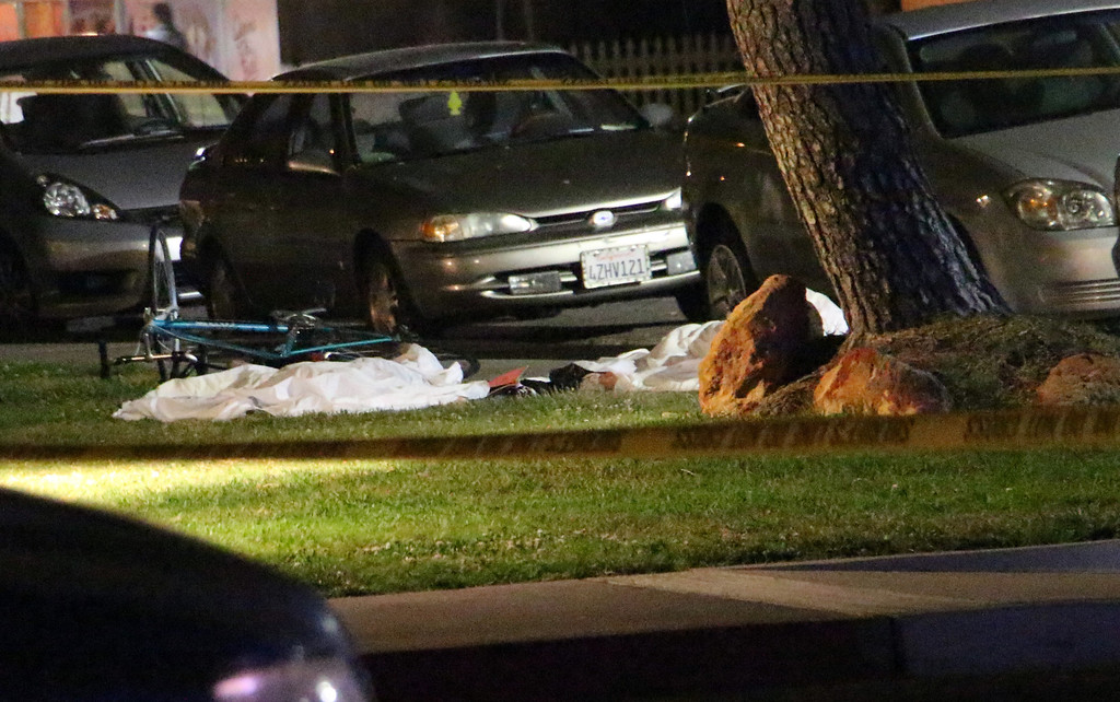 ". In this image provided by KEYT-TV, bodies are seen covered on the ground after a mass shooting near the campus of the University of Santa Barbara in Isla Vista, Calif., Friday, May 23, 2014.  A drive-by shooter went on a ""mass murder\"" rampage near the Santa Barbara university campus that left seven people dead, including the attacker, and seven others wounded, authorities said Saturday. (AP Photo/KEYT, John Palminteri)"