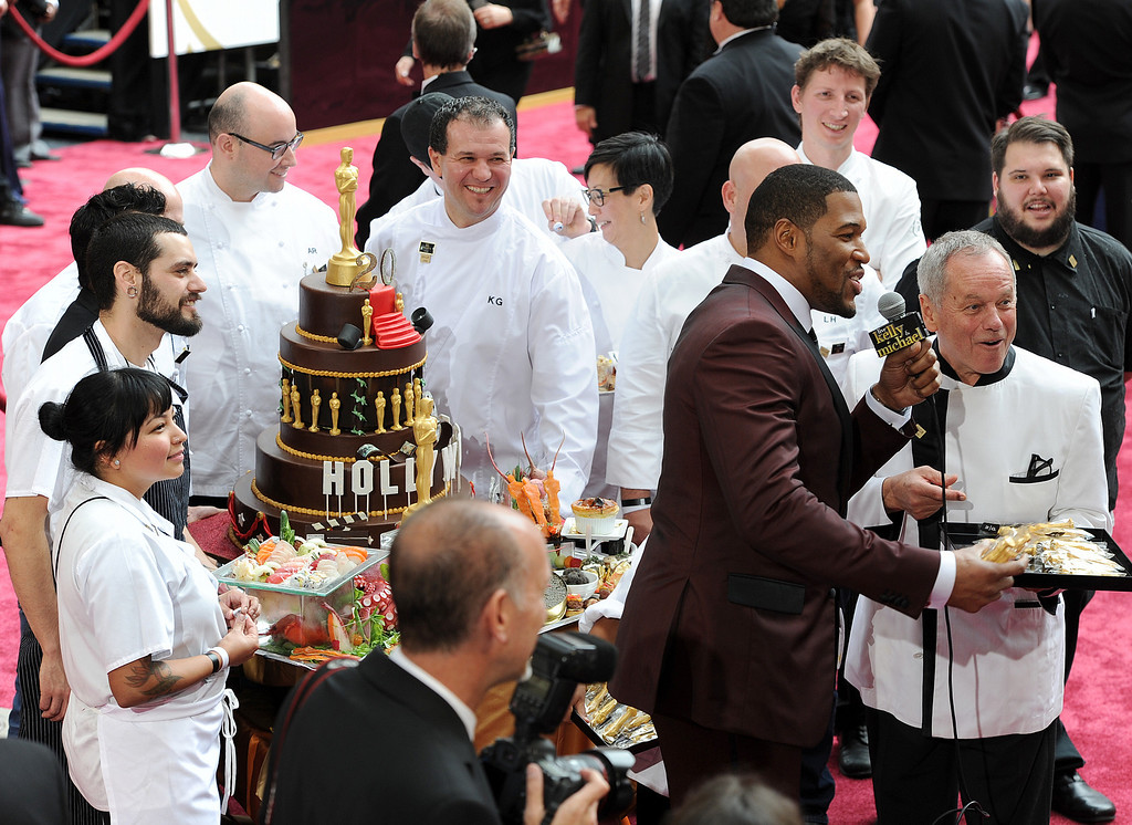 . Michael Strahan interviews Wolfgang Puck on the red carpet at  the 86th Academy Awards at the Dolby Theatre in Hollywood, California on Sunday March 2, 2014 (Photo by John McCoy / Los Angeles Daily News)