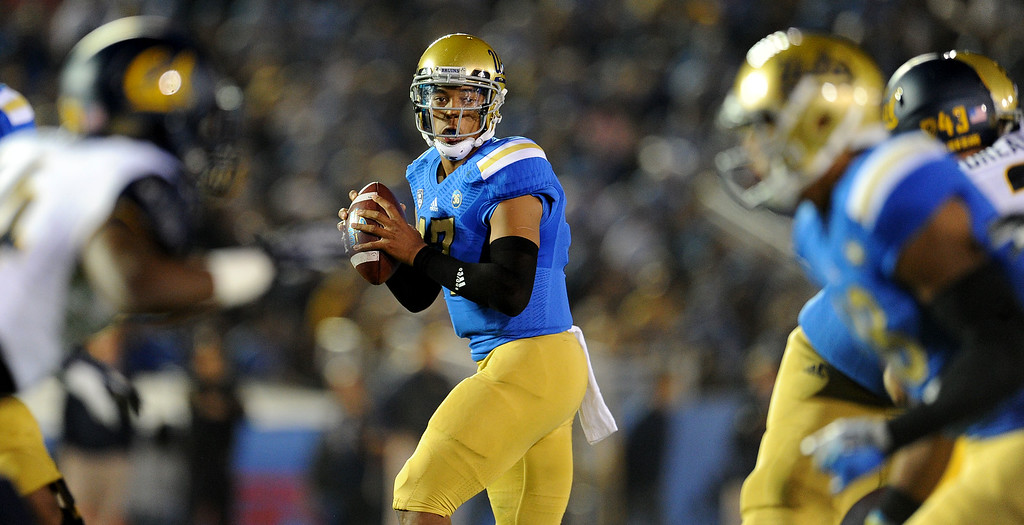 . UCLA quarterback Brett Hundley (17) waited in the pocket to pass during the first half of their college football game against California in the Rose Bowl in Pasadena, Calif., on Saturday, Oct. 12, 2013.   (Keith Birmingham Pasadena Star-News)