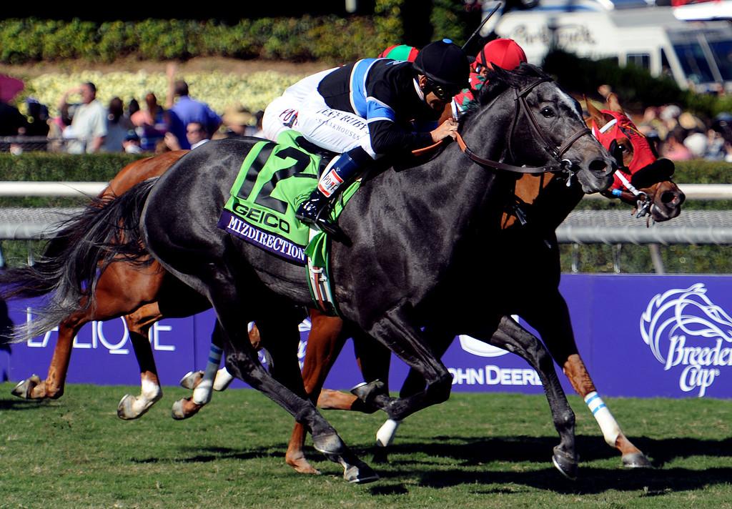 ". Jockey Mike Smith atop \""Mizdirection\"" (12) wins the Geico breeders\' cup turf sprint ahead of jockey Edwin Maldonado atop \""Reneesgotzip\"" (4) and jockey Javier Castellano atop \""Tightend Touchdwon\"" during the seventh race during the Breeders\' Cup at Santa Anita Park in Arcadia, Calif., on Saturday, Nov. 2, 2013.    (Keith Birmingham Pasadena Star-News)"