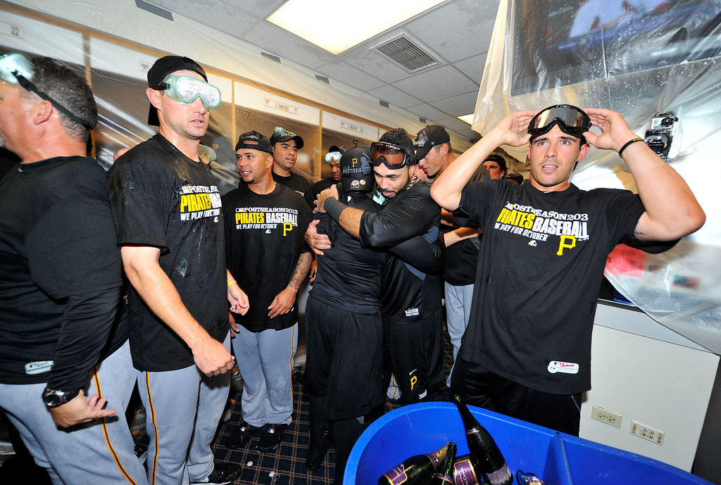 . CHICAGO, IL - SEPTEMBER 23:  The Pittsburgh Pirates celebrate after defeating the Chicago Cubs 2-1 to clinch a National League Wild Card berth at Wrigley Field on September 23, 2013 in Chicago, Illinois. The playoff berth is the first for the Pirates in 21 years.  (Photo by Brian Kersey/Getty Images)