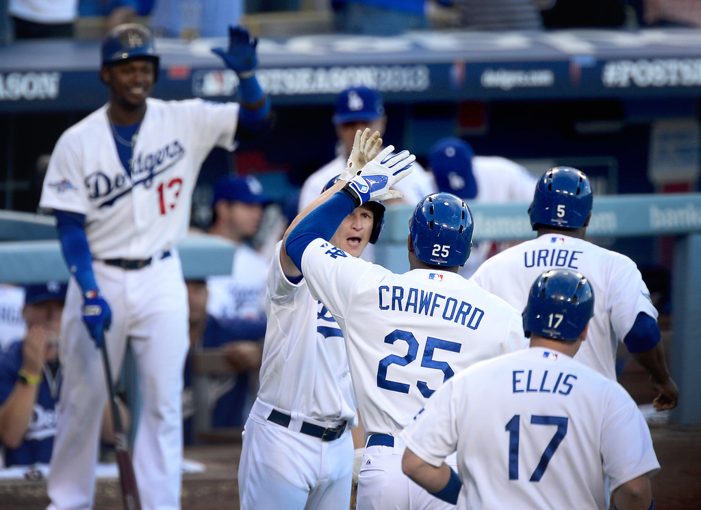 . Los Angeles Dodgers\' Carl Crawford brings in a 3-run home run with Juan Uribe and A.J. Ellis in the second inning during game 3 of the NLDS at Dodger Stadium Sunday, October 6, 2013. (Photo by Sarah Reingewirtz/Los Angeles Daily News)