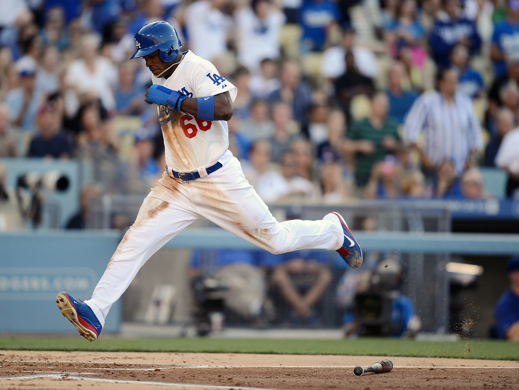 . The Dodgers\' Yasiel Puig #66 scores in the 1st inning during their game against the Reds at Dodger Stadium in Los Angeles Saturday, July 27, 2013. (Hans Gutknecht/Los Angeles Daily News)