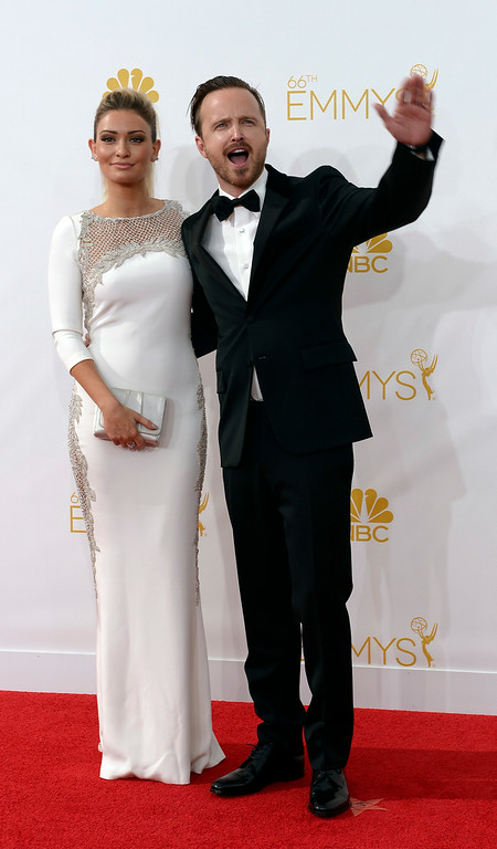 . Lauren Parsekian and Aaron Paul on the red carpet at the 66th Primetime Emmy Awards show at the Nokia Theatre in Los Angeles, California on Monday August 25, 2014. (Photo by John McCoy / Los Angeles Daily News)