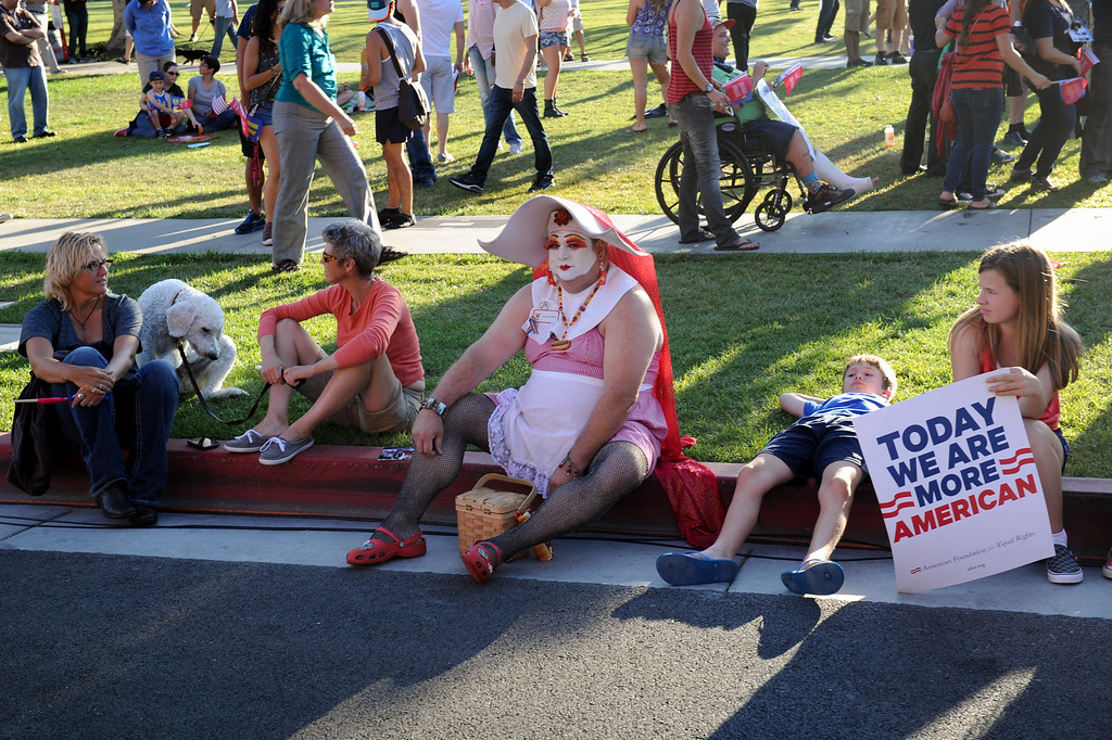 . The heat takes a toll on those attending the rally in West Hollywood to celebrate the U.S. Supreme Court\'s ruling that killed Prop 8, Wednesday, June 26, 2013. (Michael Owen Baker/L.A. Daily News)