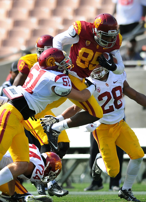 . USC WR Victor Blackwell is brought down by LB Joel Foy during their spring game, Saturday, April 19, 2014, at the Coliseum. (Photo by Michael Owen Baker/L.A. Daily News)