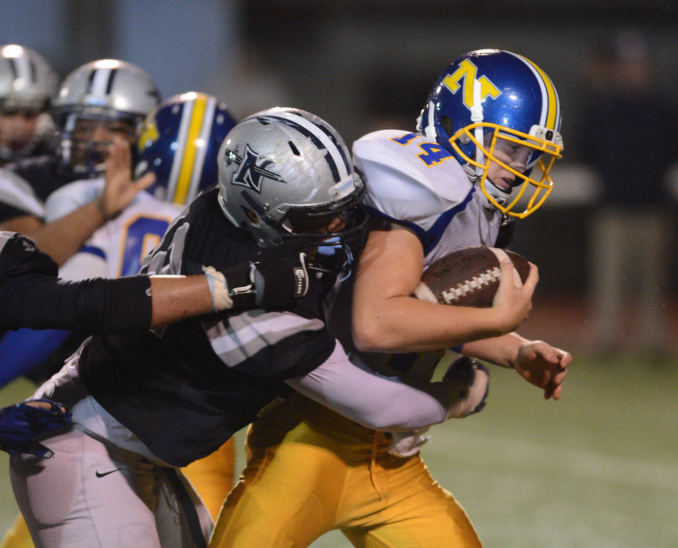 . Nordhoff QB Tanner Workman punches through North defense. North Torrance vs Nordhoff High School CIF Southern Sect. Northwest championship. 12-1-12. Photo by Brad Graverson/LANG