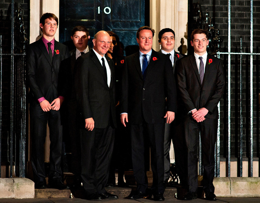 ". Britain\'s Prime Minister David Cameron, center front, and Microsoft CEO, Steve Ballmer, left front, pose for the media alongside British apprentices in the Microsoft ""Get On\"" program, after their meeting at 10 Downing Street, in London, Wednesday, Nov. 7, 2012. The Prime Minister met with Steve Ballmer to talk about the launch of Microsoft\'s �Get On� program, a three year initiative to help tackle youth unemployment in the UK.  (AP Photo/Bogdan Maran)"