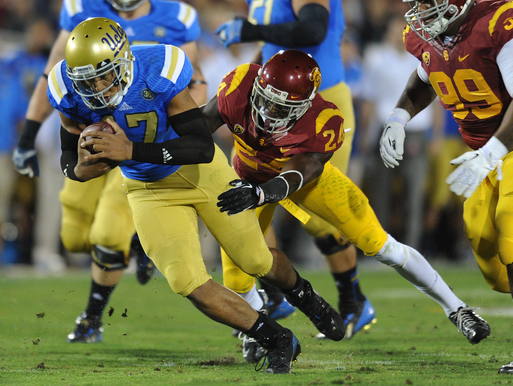 . UCLA QB Brett Hundley is sacked by USC Alec Jaffe in the 2nd quarter. UCLA and USC played in a matchup of cross town rivals at the Los Angeles Memorial Coliseum in Los Angeles, CA.  photo by (John McCoy/Los Angeles Daily News)