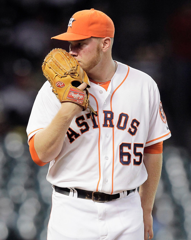 . HOUSTON, TX - SEPTEMBER 14:  Brett Oberholtzer #65 of the Houston Astros looks in at the batter against the Los Angeles Angels of Anaheim at Minute Maid Park on September 14, 2013 in Houston, Texas.  (Photo by Bob Levey/Getty Images)