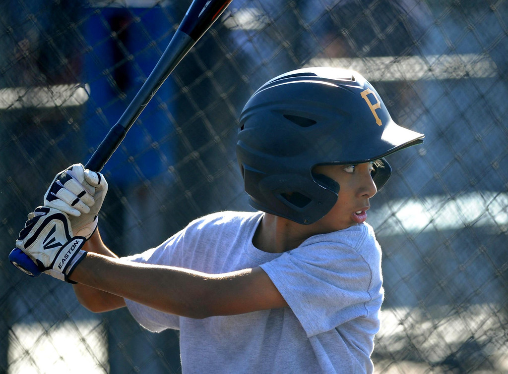 . 05-10-2013-(LANG Staff Photo by Sean Hiller)-  Lakewood Batting Cages located on Paramount and Cover Street is going out of business after 27 years  after their lease was not renewed. Nathan Blair, 12, of the Lakewood Village Little League Major Pirates practices for a playoff game.