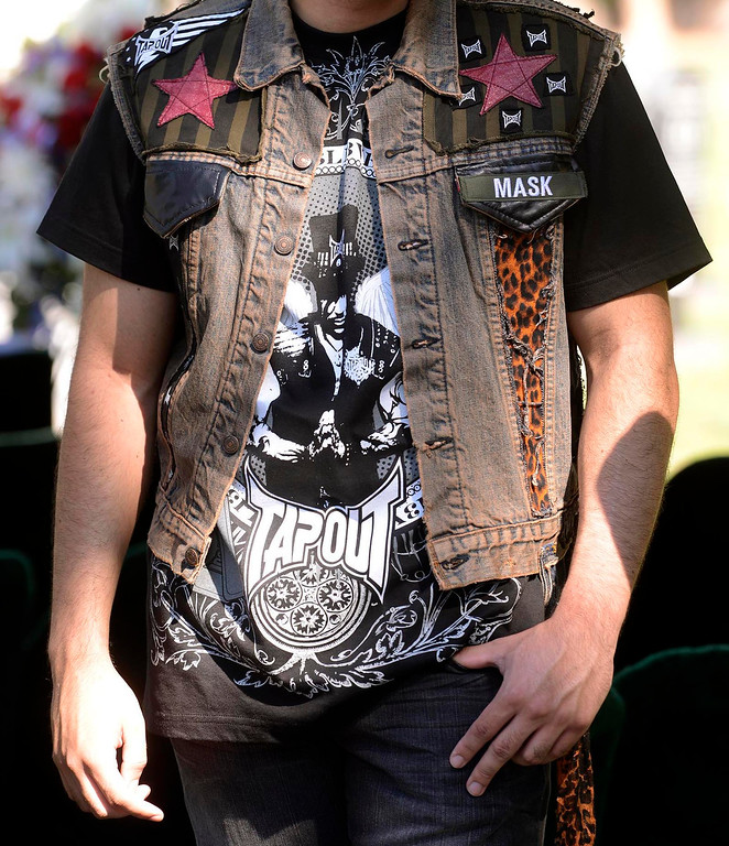""". Boaz Lews, 20, of Riverside, wore his father\'s signature vest during a tribute for Charles \""""Mask\"""" Lewis Jr. at Mountain View Cemetery in San Bernardino, CA on Saturday September 7, 2013. (Photo by Gabriel Luis Acosta/San Bernardino Sun)"""