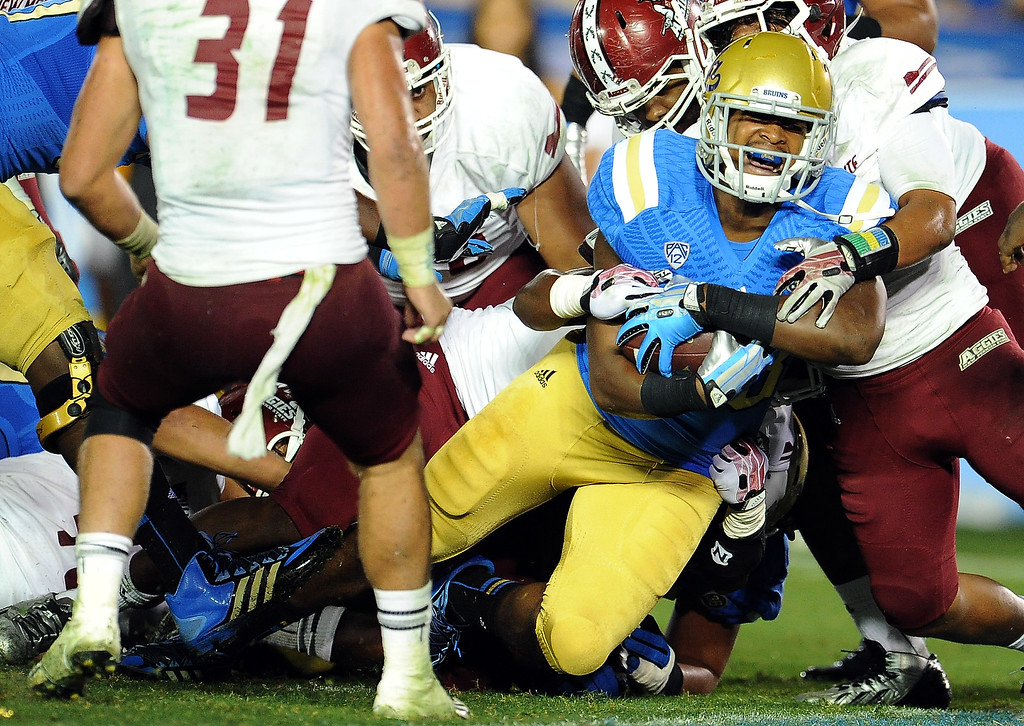 . UCLA running back Malcolm Jones runs for the touchdown against New Mexico State during the second half of their college football game in the Rose Bowl in Pasadena, Calif., on Saturday, Sept. 21, 2013.   (Keith Birmingham Pasadena Star-News)