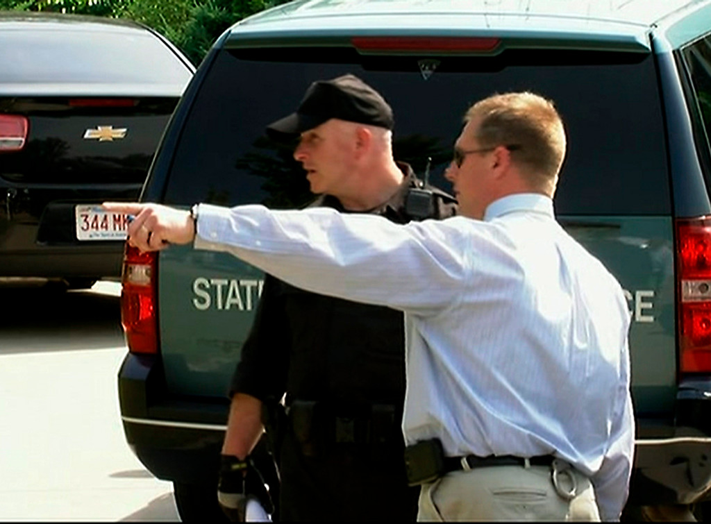 . In this image taken from video, police officers talk outside the home of New England Patriots football player Aaron Hernandez, Saturday, June 22, 2013, in North Attleboro, Mass.  State police officers and dogs searched Hernandez\'s home as they investigate the killing of Odin Lloyd, a semi-pro football player whose body was found nearby. (AP Photo/ESPN)