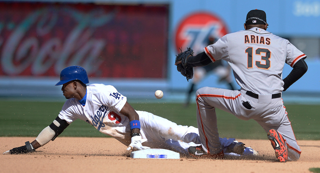 . Dodgers Dee Gordon steals second base, and then advanced to 3rd when Giants #13 Joaquin Arias could not handle the throw in the 6th inning. The Dodgers played the San Francisco Giants on Opening Day at Dodger Stadium. Los Angeles, CA. April 3, 2014 (Photo by John McCoy / Los Angeles Daily News)