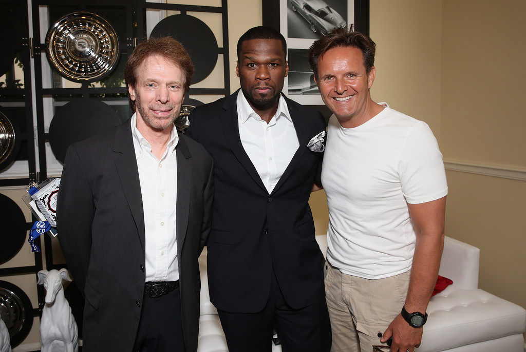 """. From left, Jerry Bruckheimer, Curtis \""""50 Cent\"""" Jackson and Mark Burnett attend the second day of the 2013 Produced by Conference on Sunday, June 9, 2013 in Los Angeles. (Photo by Todd Williamson/Invision for Producers Guild/AP Images)"""