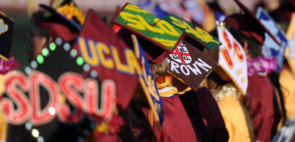 . Colorful caps during the La Canada High School commencement at La Canada High School on Thursday, June 13, 2013 in La Canada, Calif.