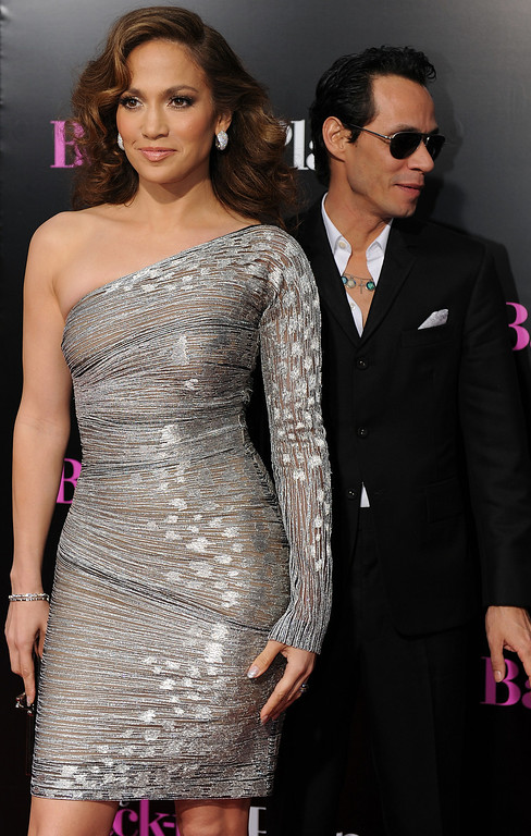 ". Actress Jennifer Lopez arrives with her husband, singer Marc Anthony at the premiere of ""The Back-up Plan\"" in Westwood, California, on April 21, 2010.  (GABRIEL BOUYS/AFP/Getty Images)"
