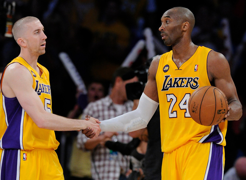 . Lakers#5 Steve Blake and Kobe Bryant shake hands after the game. The Lakers defeated New Orleans Hornets 104-96 in a game played at Staples Center in Los Angeles, CA 4/9/2013(John McCoy/Los Angeles Daily News